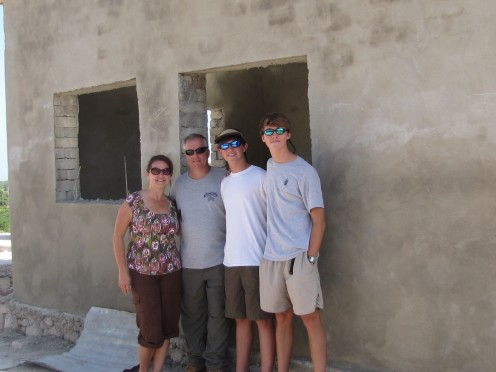Our family posing in front of the clinic before we answered God's call.
