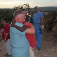 Tony gets a big hug from Esther Geoffroi after he returned from a visit to the states in October.