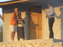 Daniel, our new pastor at Hope Center, takes a picture of Stan Buckley and one of our new residents on the Hill at Hope Center as she receives the keys to her new home. Thank you Lord for Your provision!!!