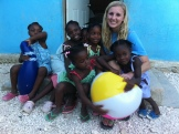 Katelyn getting a little lovin' from all the kids at the orphanage