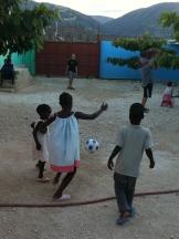 Jonathan playing soccer with Stephenson, Dana, & Gillot