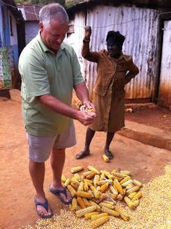 Tony helping Grandma with the corn preparation.