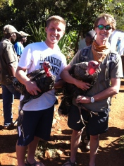Jacob and Jonathan holding the two turkeys we purchased for Thanksgiving dinner.