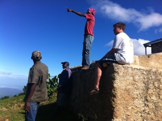 Alex and Jacob on top of the mountain cistern on Pastor Joel's property. Alex is pointing over to the DR.