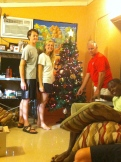 Katelyn, Jonathan, & Tony decorating the Christmas tree.