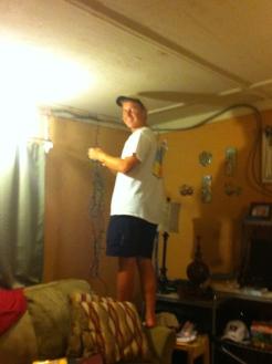 Jacob hung lights around the room to make it more festive.