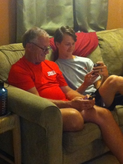 Jonathan and Tony looked over photos on Jonathan's phone from the week.