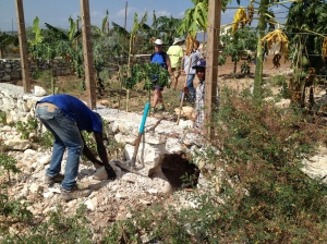 Doug, Charles, Pierre, & Junior working on the orphanage garden