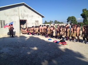 All of the children gathered outside the school for the pledge and national anthem before school.