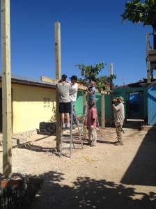 Pensacola & Laurens men working with Makil on the orphanage shade area