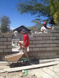 Adam, Greg, and Rawls working hard on Johnny's house