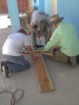 Charles, Randy, & James working on benches