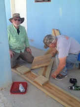 Carl and James work on benches for the church.
