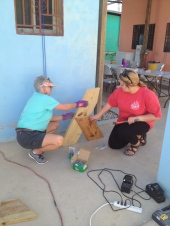 Alyssa and Patricia help with benches