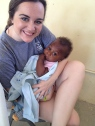 Katie holding babies outside Hope Center Clinic