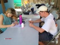 Jacob and Madison counting pills