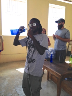 Alex demonstrates how cool it looks to drink from the water bottle with his shades on. ha!
