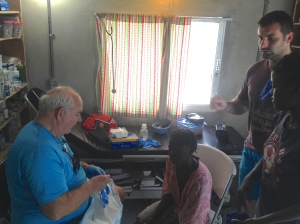 Tom & Jonathan take care of Esther in the clinic.