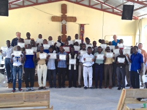 The pastors that attended the pastors' conference showing off their certificates at the end of the conference.