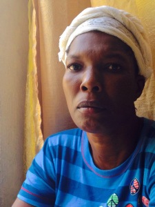 Jesula has a terrible breast tumor that has to be cleaned daily and causes her intense pain. She is now receiving chemotherapy in a cancer center in Port au Prince