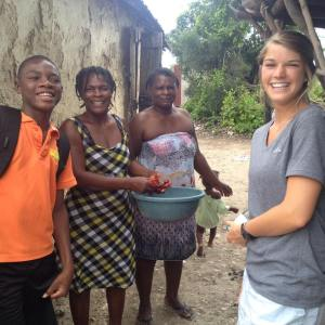 Leyna visiting with Bicly's family in the village.