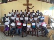 The first graduating class of students from Mickie's first beginner English class