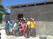 Beersheba Pres Team in front of the house they built for a family in our village