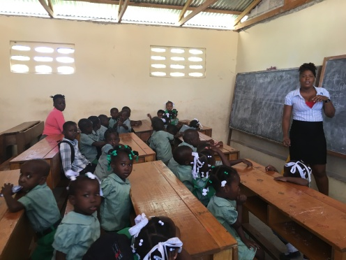 Classroom full of children with uniforms LEARNING!