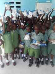 Children in Maranatha school receiving Manna Packs
