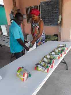 President of Handicapped Association and his wife preparing food distribution